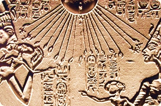 The Sun blesses a Pharaoh with his family: Akhenaten, Nefertiti and their children in Limestone